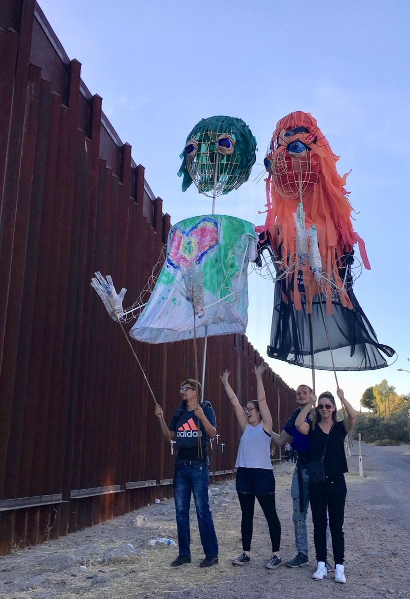 Artist Puppetistas on the U.S. side of the Border Wall