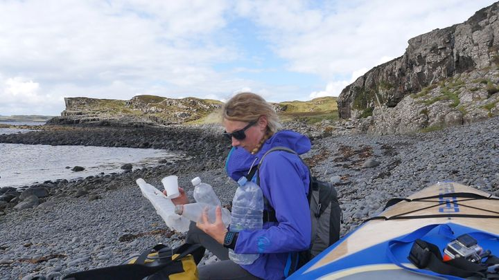 Cal Major holds some of the plastic trash she collected on the Isle of Skye.