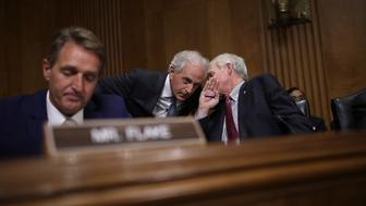 WASHINGTON, DC - NOVEMBER 14:  Sen. Bob Corker (C) (R-TN), chairman of the Senate Foreign Relations Committee, confers with Sen. Ron Johnson (R) (R-WI) during a committee hearing November 14, 2017 in Washington, DC. The committee heard testimony on the 'Authority to Order the Use of Nuclear Weapons.' Also pictured is Sen. Jeff Flake (R) (R-AZ). (Photo by Win McNamee/Getty Images)