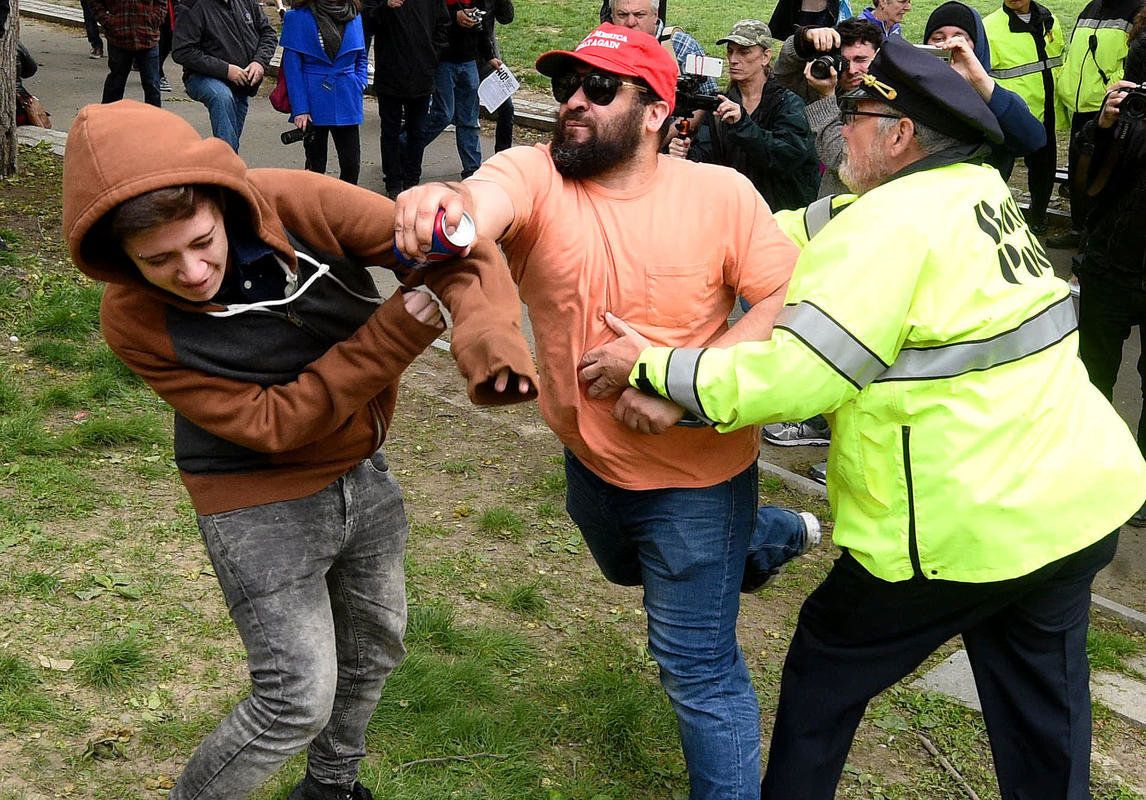 (Boston MA 05/13/17) A Trump supporter wearing a Make America Great Again cap, right, takes a swing at a counter protester who rushed him after the Trump supporter used a Pepsi to taunt the anti-Trump protesters mimicking the Pepsi commercial with racial overtones, both were arrested, during a large demonstration on 6 different militias and a counter protest, Saturday, May 13, 2017, on the Boston Common.  (Boston MA 05/13/17) A Trump supporter wearing a Make America Great Again cap, right, takes a swing at a counter protester who rushed him after the Trump supporter used a Pepsi to taunt the anti-Trump protesters mimicking the Pepsi commercial with racial overtones, both were arrested, during a large demonstration on 6 different militias and a counter protest, Saturday, May 13, 2017, on the Boston Common.