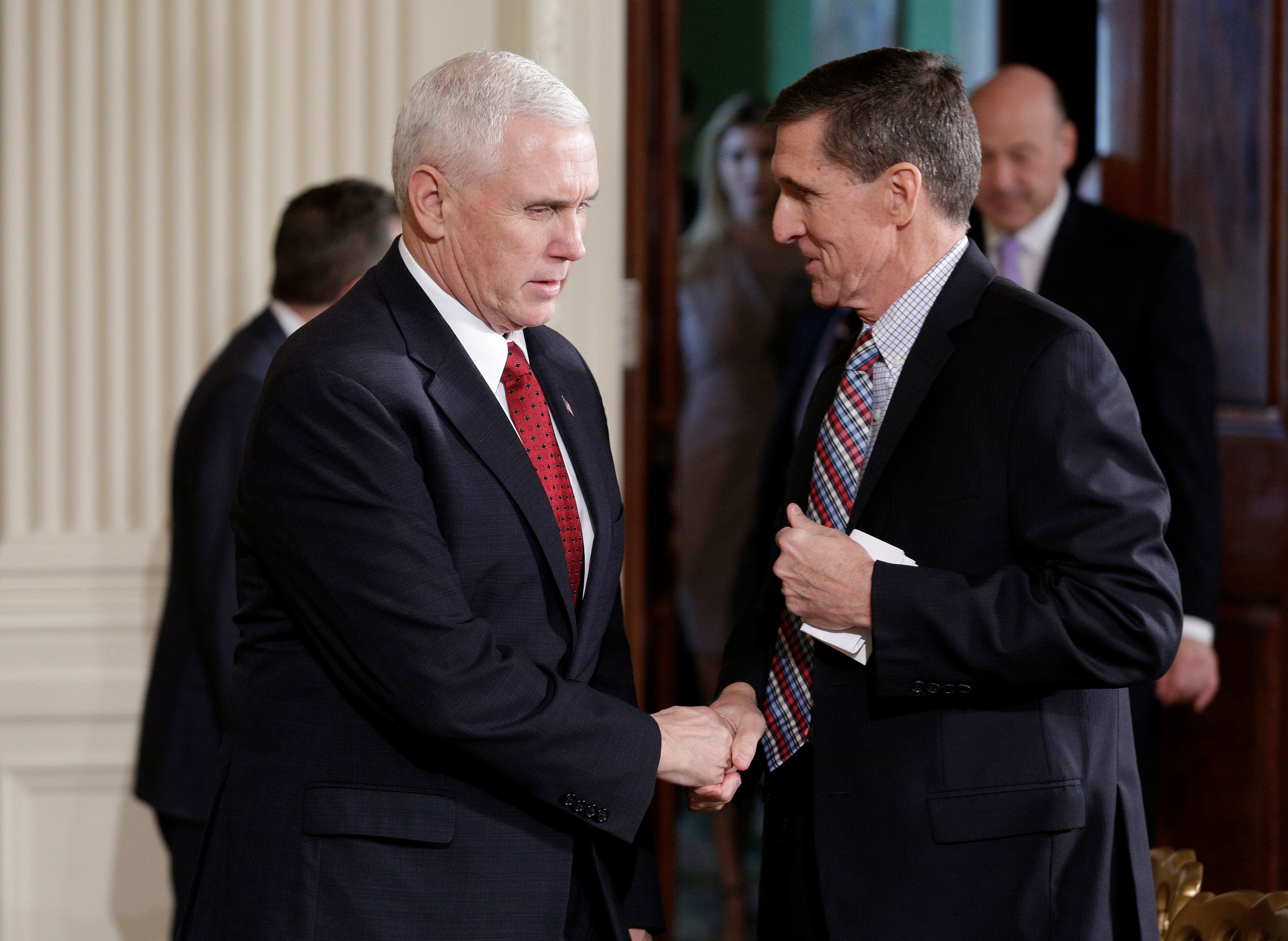 U.S. Vice President Mike Pence greets National Security Advisor Michael Flynn before Japanese Prime Minister Shinzo Abe and U.S. President Donald Trump arrive for their joint news conference at the White House in Washington, U.S., February 10, 2017.     REUTERS/Joshua Roberts