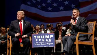 Republican presidential nominee Donald Trump (L) speaks along side retired U.S. Army Lieutenant  General Mike Flynn during a campaign town hall meeting in Virginia Beach, Virginia, U.S., September 6, 2016.  REUTERS/Mike Segar