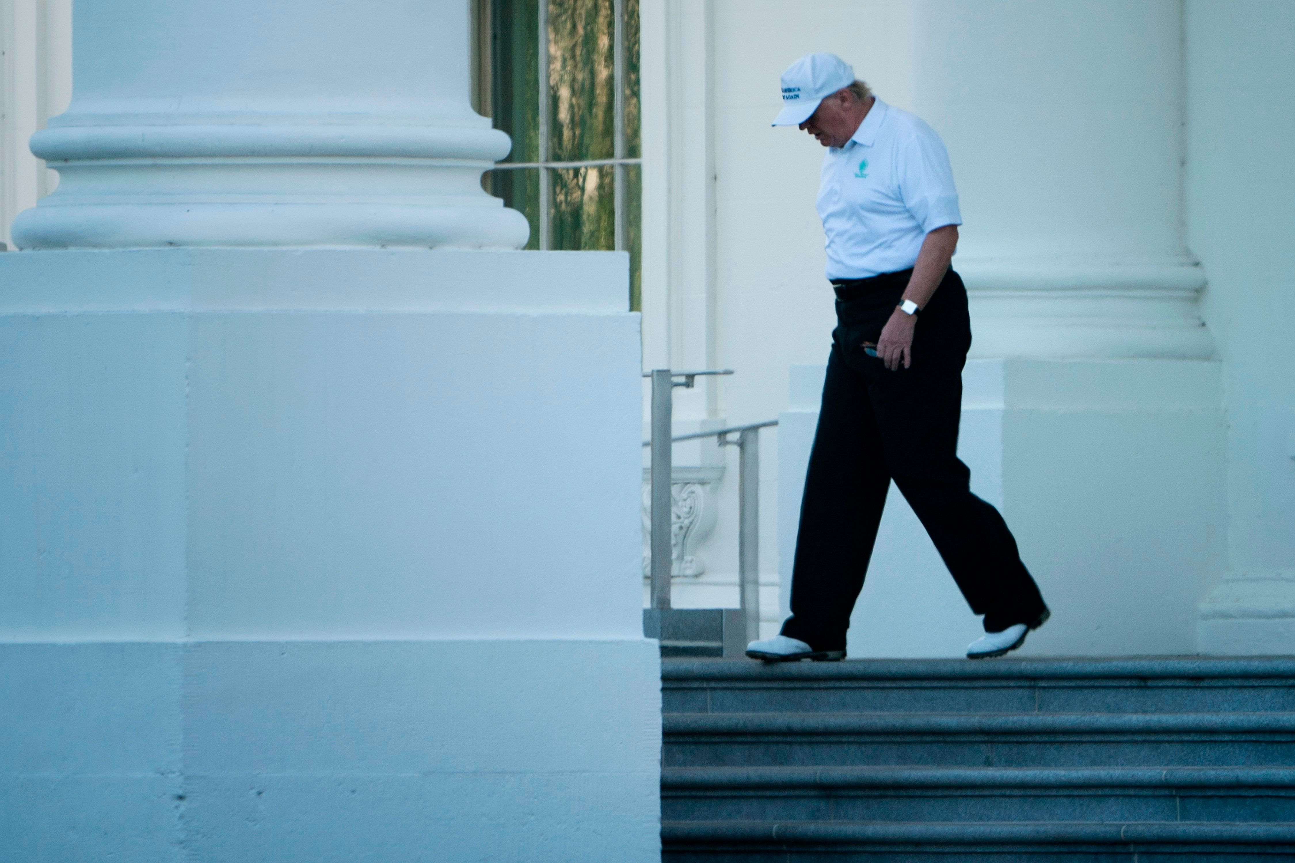 US President Donald Trump walks from the White House to his motorcade before traveling to his Virginia golf club on October 21, 2017 in Washington, DC. / AFP PHOTO / Brendan Smialowski        (Photo credit should read BRENDAN SMIALOWSKI/AFP/Getty Images)