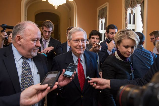 Senate Majority Leader Mitch McConnell (R-Ky.) talks to reporters Friday, several hours before the early...