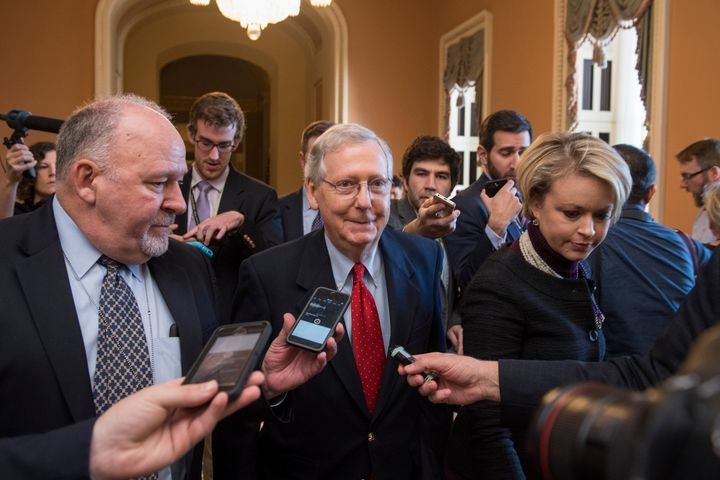 Senate Majority Leader Mitch McConnell (R-Ky.) talks to reporters Friday, several hours before the early Saturday vote.