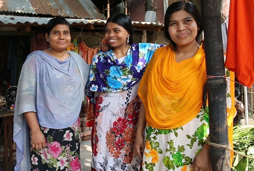 From left to right: Lipa, Shormila, Shipra sisters who learned how to sew and start a business through the organization BRAC.
