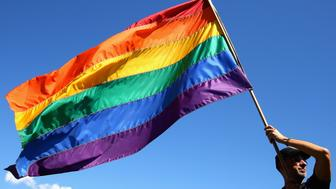 SYDNEY, AUSTRALIA - NOVEMBER 15:  Prominent Sydney artist Chris Lewis proudly flies his much loved Rainbow flag  on November 15, 2017 in Sydney, Australia. Australians have voted for marriage laws to be changed to allow same-sex marriage, with the Yes vote claiming 61.6% to to 38.4% for No vote. Despite the Yes victory, the outcome of Australian Marriage Law Postal Survey is not binding, and the process to change current laws will move to the Australian Parliament in Canberra.  (Photo by Don Arnold/Getty Images)