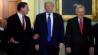 U.S. President Donald Trump walks with Senator John Barrasso (R-WY) and Senate Majority Leader Mitch McConnell in the U.S. Capitol for a meeting with Senate Republicans about tax legislation in Washington, U.S., November 28, 2017.  REUTERS/Kevin Lamarque