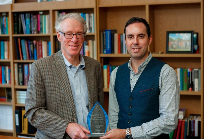 "<em>Dr. Jon Wolpaw and research team member Dr. Amir Eftekhar with a recent award for ""Most Innovative"" at the 2017"