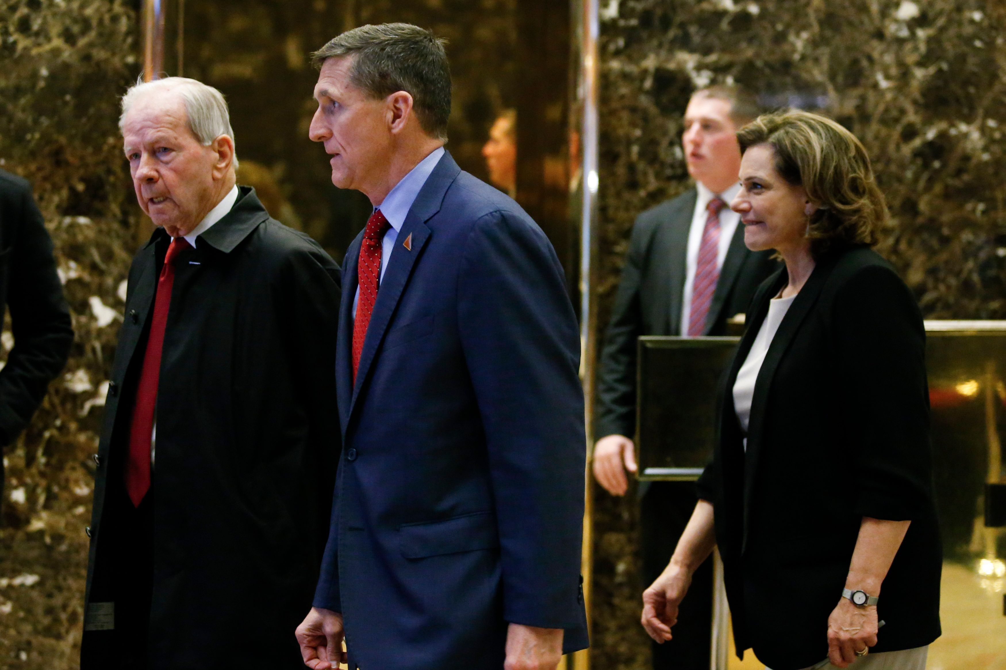 Robert. C. 'Bud' McFarlane, Michael Flynn and KT McFarland walk in the lobby at Trump Tower in New York on Dec. 5, 2016.