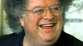 James Levine smiles after being announced as the next conductor and music director of The Boston Symphony Orchestra October 29, 2001 at a news conference at Symphony Hall in Boston. Levine, who is currently New York Metropolitan Opera artistic director will be the first American to hold the post in BSO's 120-year history. Levine will replace conductor Seiji Ozawa starting in the 2004-2005 season after Ozawa's departure to Vienna. REUTERS/Jim Bourg  JRB