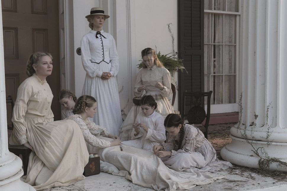 "Sofia Coppola has done it again. In ""The Beguiled,"" she dresses a tart comedy of manners in shades of Southern"