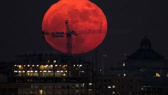 WASHINGTON, DC - DECEMBER 3: In this handout provided by NASA, the moon is seen as it rises on December 3, 2017 in Washington, DC.  Today's full Moon is the first of three consecutive supermoons. The two will occur on Jan. 1 and Jan. 31, 2018. A supermoon occurs when the moon's orbit is closest (perigee) to Earth at the same time it is full. (Photo by NASA/Bill Ingalls via Getty Images)