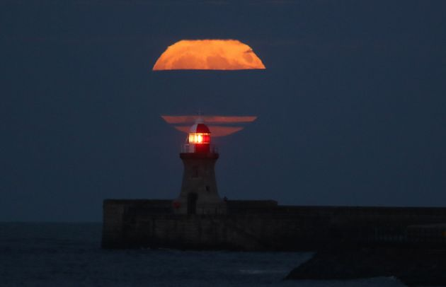Supermoon above the lighthouse at South Shields, Tyne &