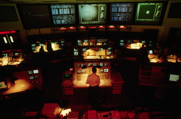 Corbis via Getty Images                   The original Voyager 2 mission control room. Things have changed quite a bit since then