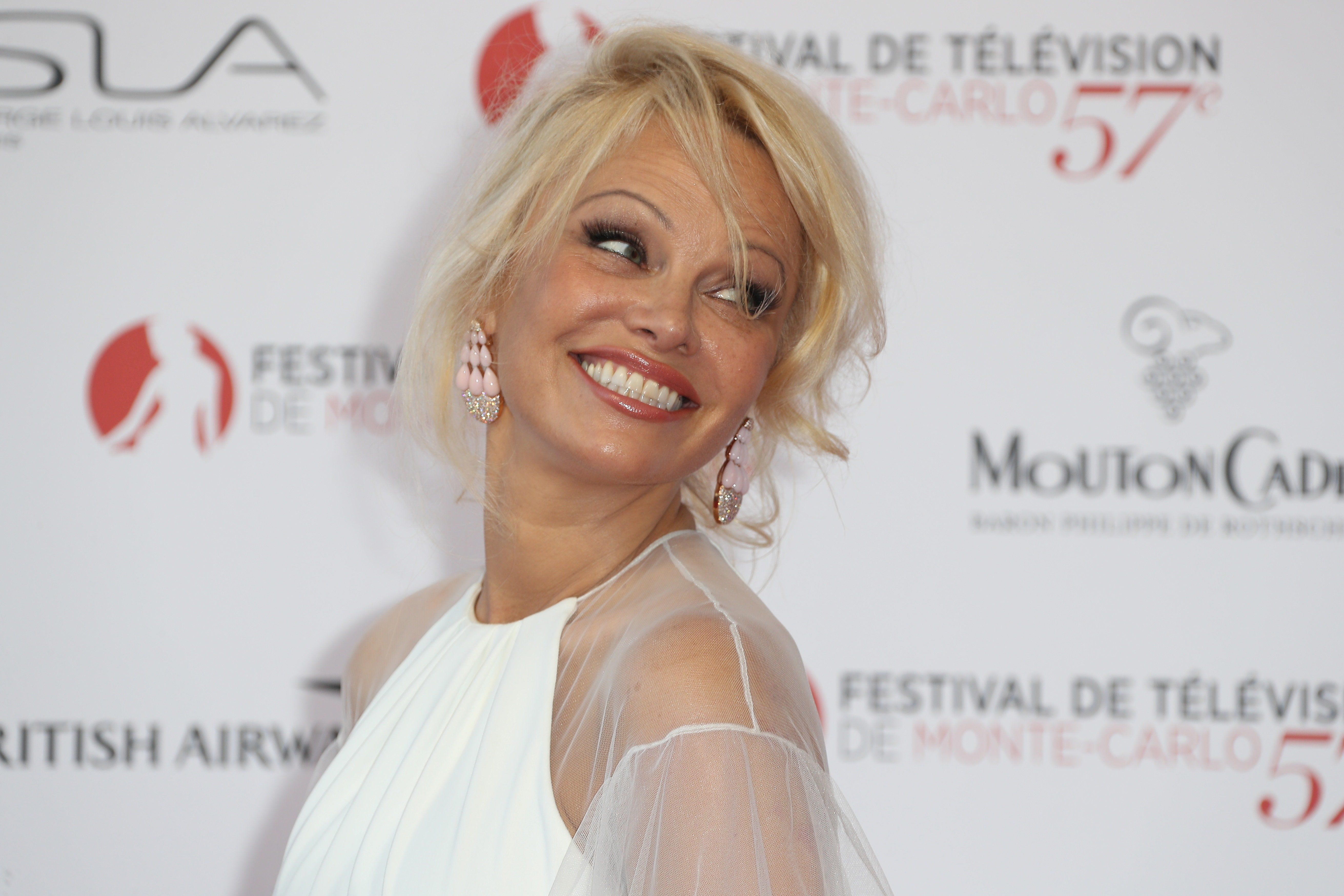 US actress Pamela Anderson poses during the opening Ceremony of the 57th Monte-Carlo Television Festival on June 16, 2017 in Monaco.  / AFP PHOTO / VALERY HACHE        (Photo credit should read VALERY HACHE/AFP/Getty Images)