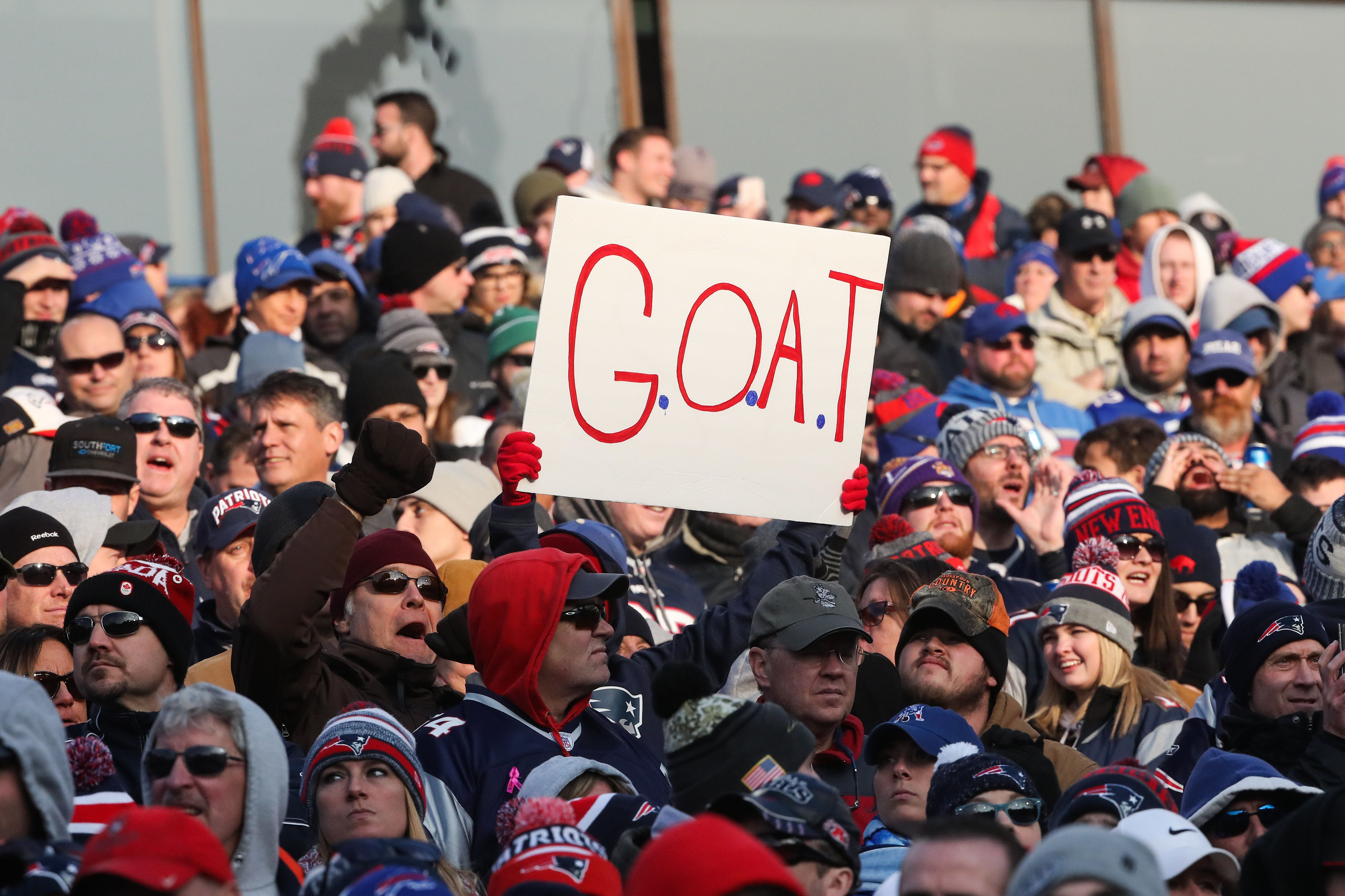 ORCHARD PARK, NY - DECEMBER 3:  A New England Patriots fan holds up a sign during the fourth quarter against the Buffalo Bills on December 3, 2017 at New Era Field in Orchard Park, New York.  (Photo by Tom Szczerbowski/Getty Images)