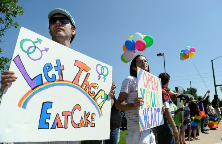 Charlie Craig (left) and David Mullins (second from left) and their supporters protest against Masterpiece Cakeshop