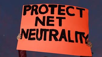 Students protest during a rally to 'Protect Net Neutrality' as they voice their opposition to the impending FCC vote, outside the Federal Building in Los Angeles, California on November 28, 2017.   Organizers say 'that a ruling in favor of repealing the 2015 rules could result in internet service providers prioritizing connection speeds to certain sites, such as advertisers, with access to certain websites being restricted at the service providers discretion and the opportunity to raise fees for access that otherwise is free'. / AFP PHOTO / Mark RALSTON        (Photo credit should read MARK RALSTON/AFP/Getty Images)