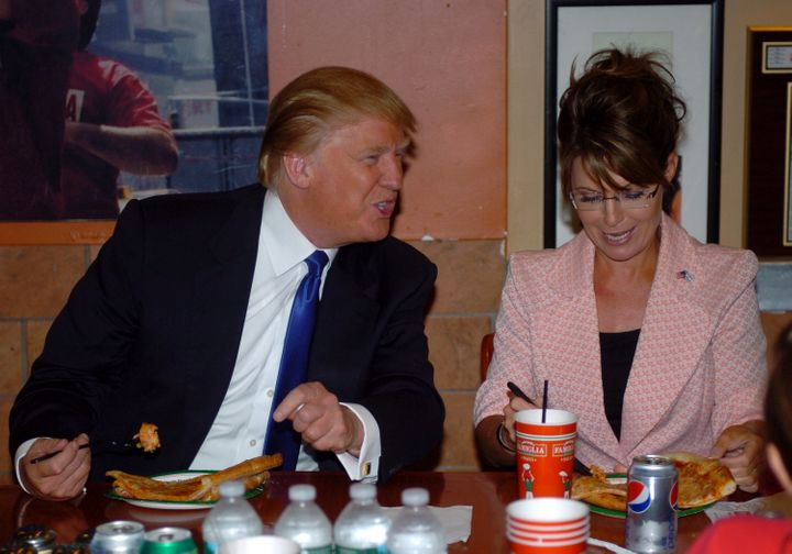 Sarah Palin and Donald Trump eating pizza at a Famiglia on Broadway.