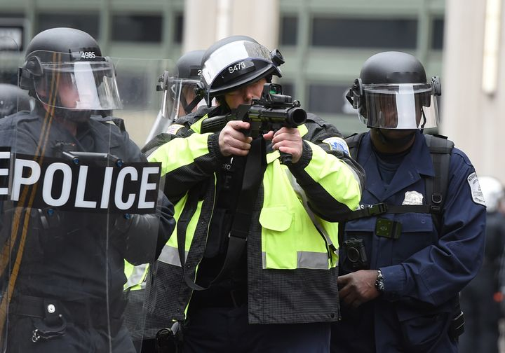 Police prepare to fire tear gas at protesters during the inauguration protests.