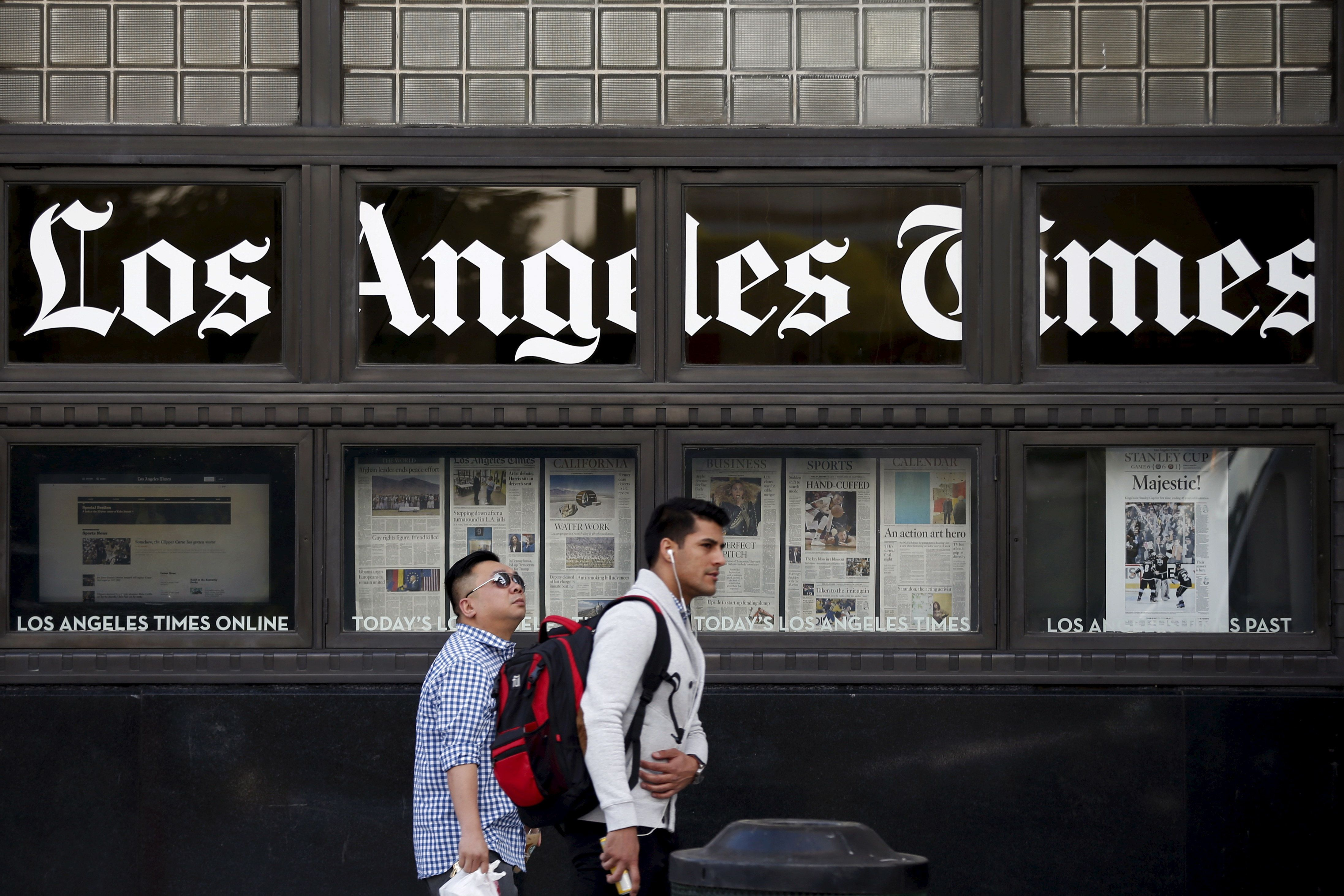 Lucy Nicholson  Reuters People walk past the LA Times building in Los Angeles