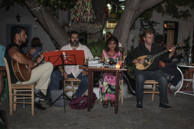 Greek musicians performing in a town square in late at night