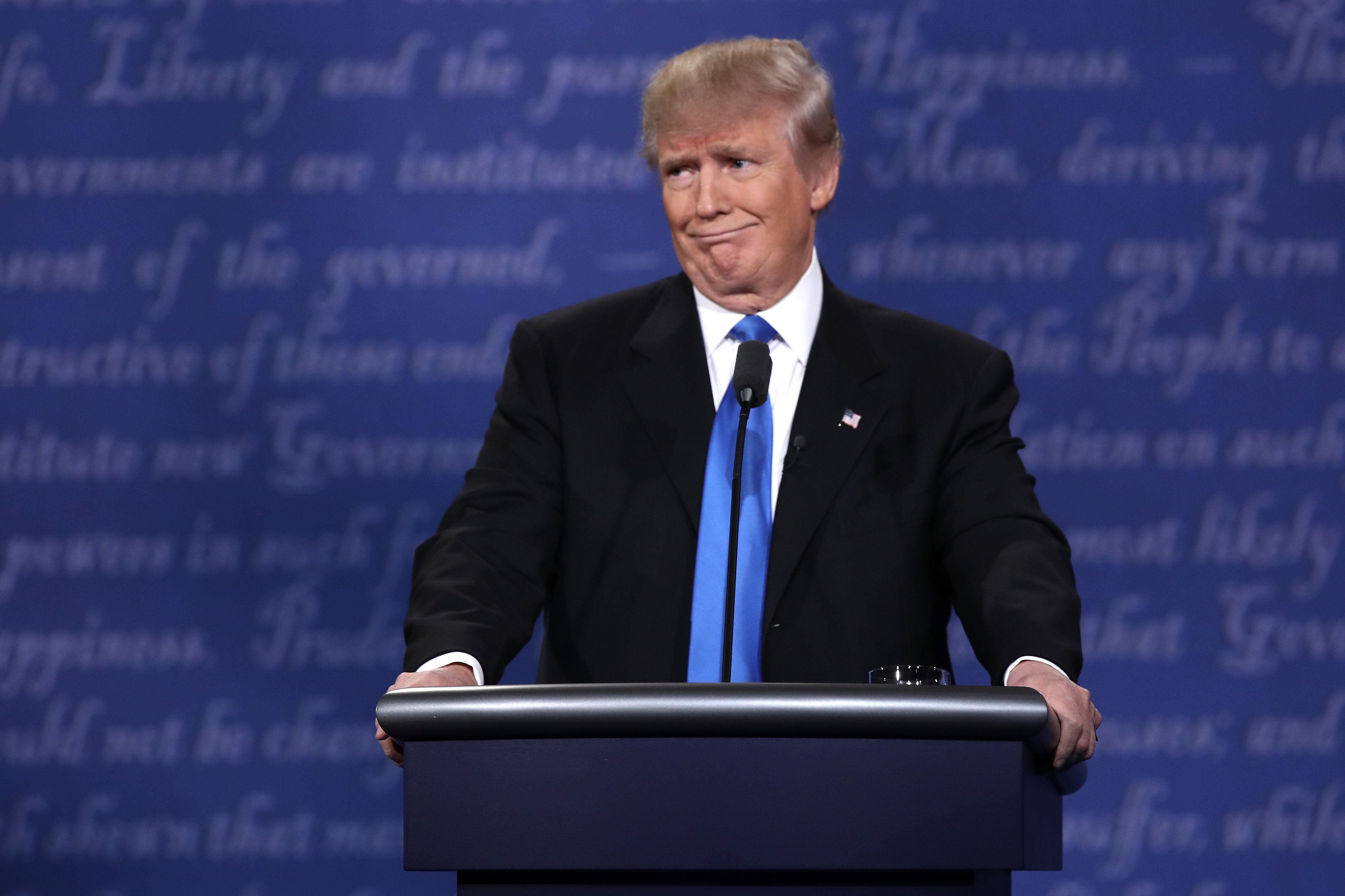 HEMPSTEAD, NY - SEPTEMBER 26:  Republican presidential nominee Donald Trump makes a face during the Presidential Debate at Hofstra University on September 26, 2016 in Hempstead, New York.  The first of four debates for the 2016 Election, three Presidential and one Vice Presidential, is moderated by NBC's Lester Holt.  (Photo by Win McNamee/Getty Images)