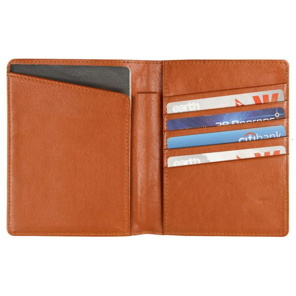 This wallet holds two passports, cash, cards, boarding pass, and a pen. It's a sleek way to keep all of your travel essential