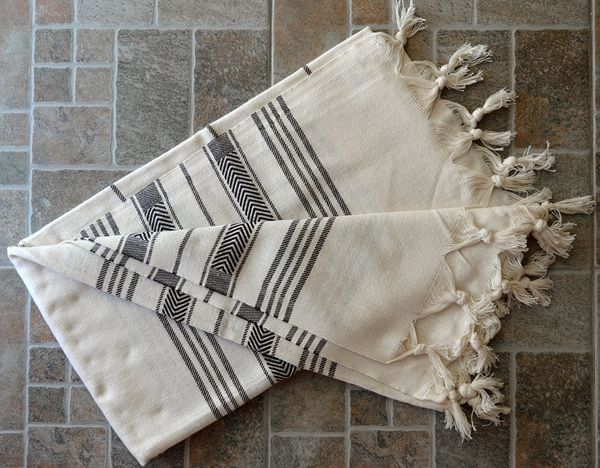 Travelers know that versatility is key. A Turkish bath towel can be used as a scarf, a beach towel, a coverup, a blanket and,
