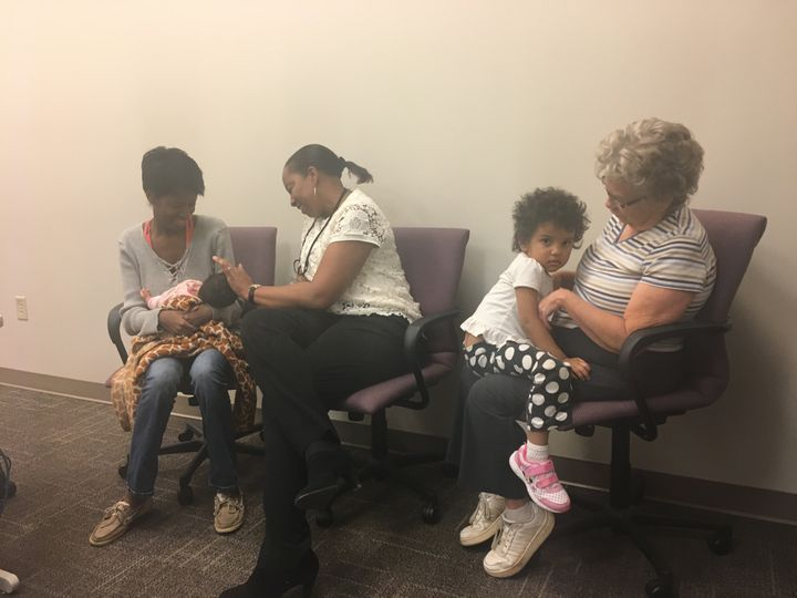 <p>From left to right, Hannah White with her newborn Maddilyn, Denise Duckett, her case manager, Nala, her 2-year-old daughter, and mother, Breta White, soon after her postpartum visit to the Mountain Area Education Health Center in Asheville, North Carolina.</p>