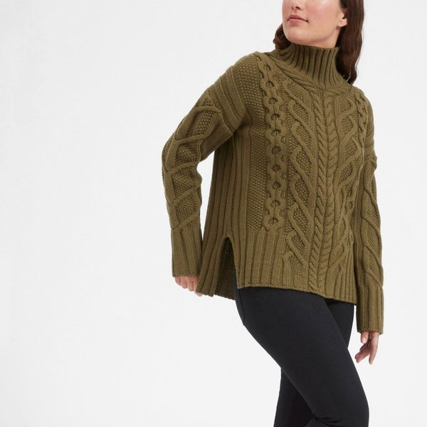 """<a href=""""https://www.everlane.com/products/womens-oversized-cable-turtleneck-surplus?collection=womens-sweaters"""" target=""""_bla"""