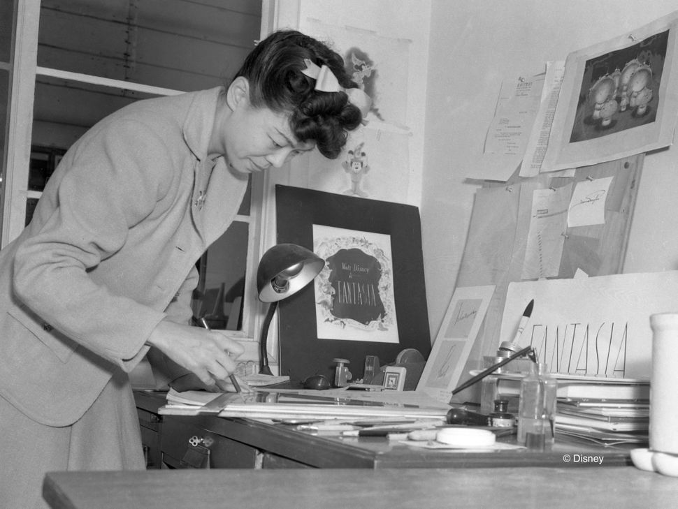"Artist Gyu Fujikawa works on a ""Fantasia"" product, circa 1939."