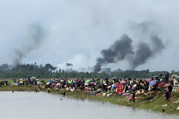 Smoke billows above what is believed to be a burning village in Myanmar's Rakhine state as members of the Rohingya Muslim min