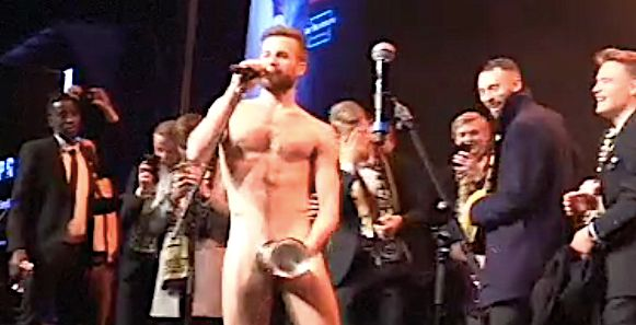 Norwegian Soccer Star Performs Strip-Tease With Championship Trophy (NSFW)