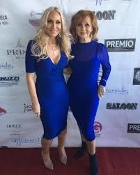 Website AllAboutTheTea.com got an advanced photo of Kim D. (pictured on the left) in the 2017 Posche fashion show.