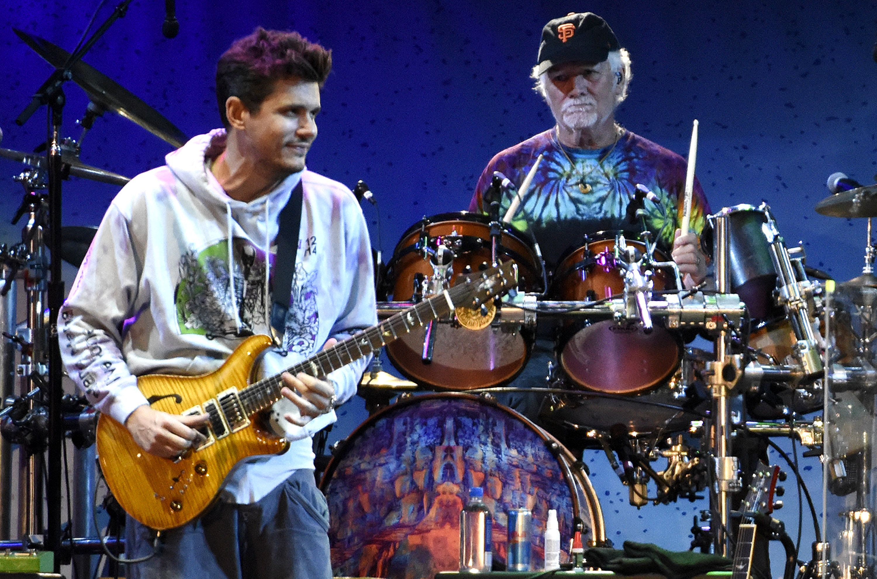 SAN FRANCISCO, CA - NOVEMBER 09:  John Mayer (L) and Bill Kreutzmann of Dead & Company perform during Band Together Bay Area Fire Benefit Concert at AT&T Park on November 9, 2017 in San Francisco, California.  (Photo by Tim Mosenfelder/Getty Images)