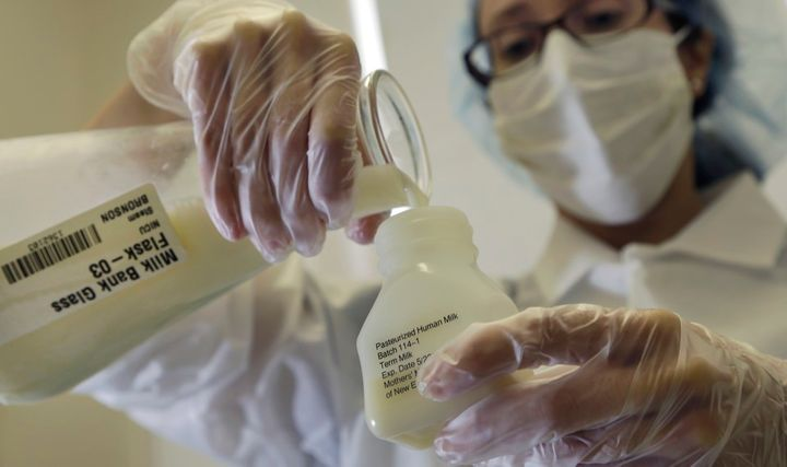 <p>A lab technician at Mothers&#39; Milk Bank Northeast, in Massachusetts, pours donated breast milk into a plastic bottle for pasteurization. </p>