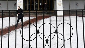 A man walks in front of the Russian Olympic Committee (ROC) building in Moscow on December 05, 2017. The International Olympic Committee (IOC) meets from Tuesday, December 5, 2017 to decide whether to bar Russia from the 2018 Winter Olympics for doping violations, in one of the weightiest decisions ever faced by the Olympic movement. / AFP PHOTO / Kirill KUDRYAVTSEV        (Photo credit should read KIRILL KUDRYAVTSEV/AFP/Getty Images)