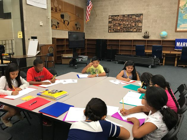 Students from a school in Kennett Square, Pennsylvania, working on a book about immigration...