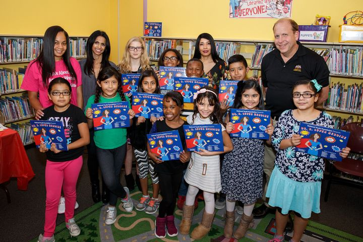 National Youth Foundation co-founder Sophia Hanson (center, back row) with students who participated in a book-writing projec