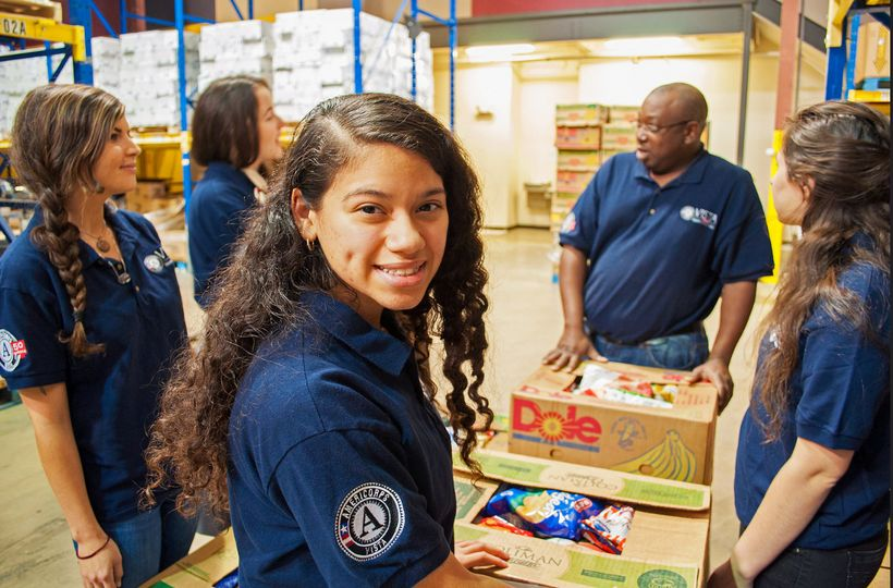 AmeriCorpsVISTA volunteers work at an Austin, Texas, food bank.
