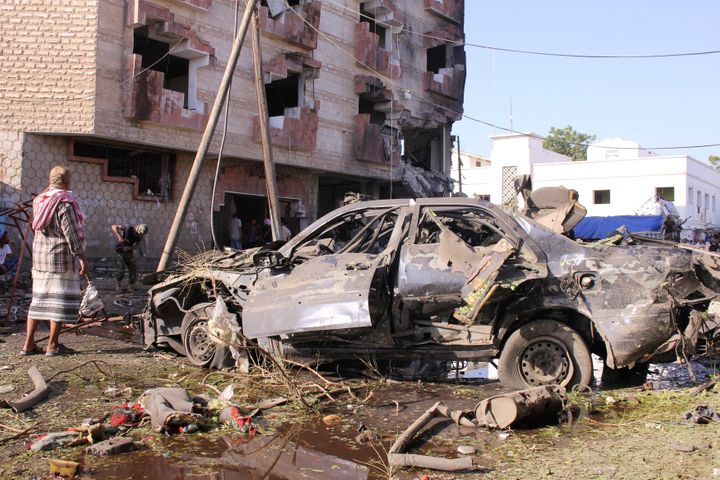 A damaged vehicle is seen at the site of a car bomb attack in the Yemeni city of Aden on Nov. 29.