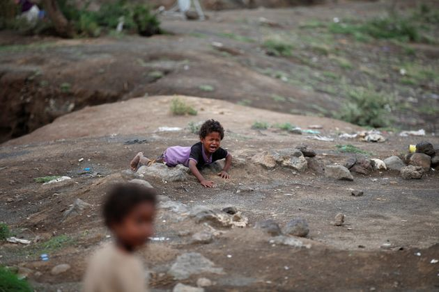 A boy cries at a camp for displaced people near the Yemeni capital of Sana'a on Aug. 10,