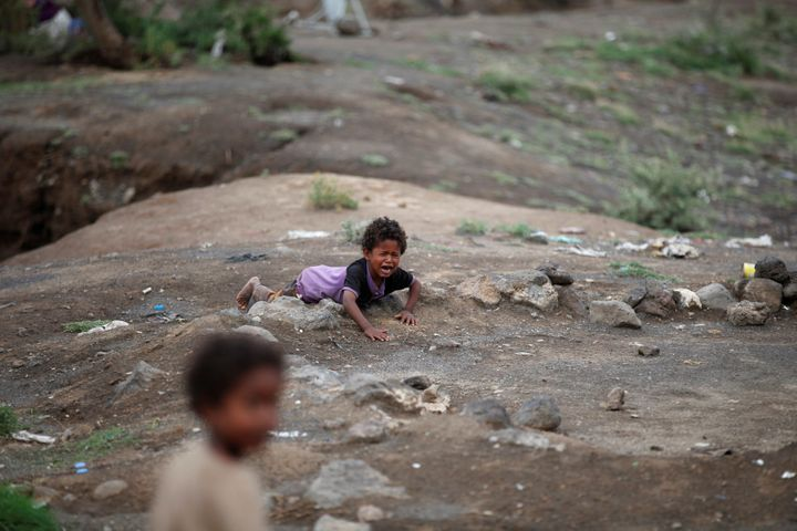 A boy cries at a camp for displaced people near the Yemeni capital of Sana'a on Aug. 10, 2016.