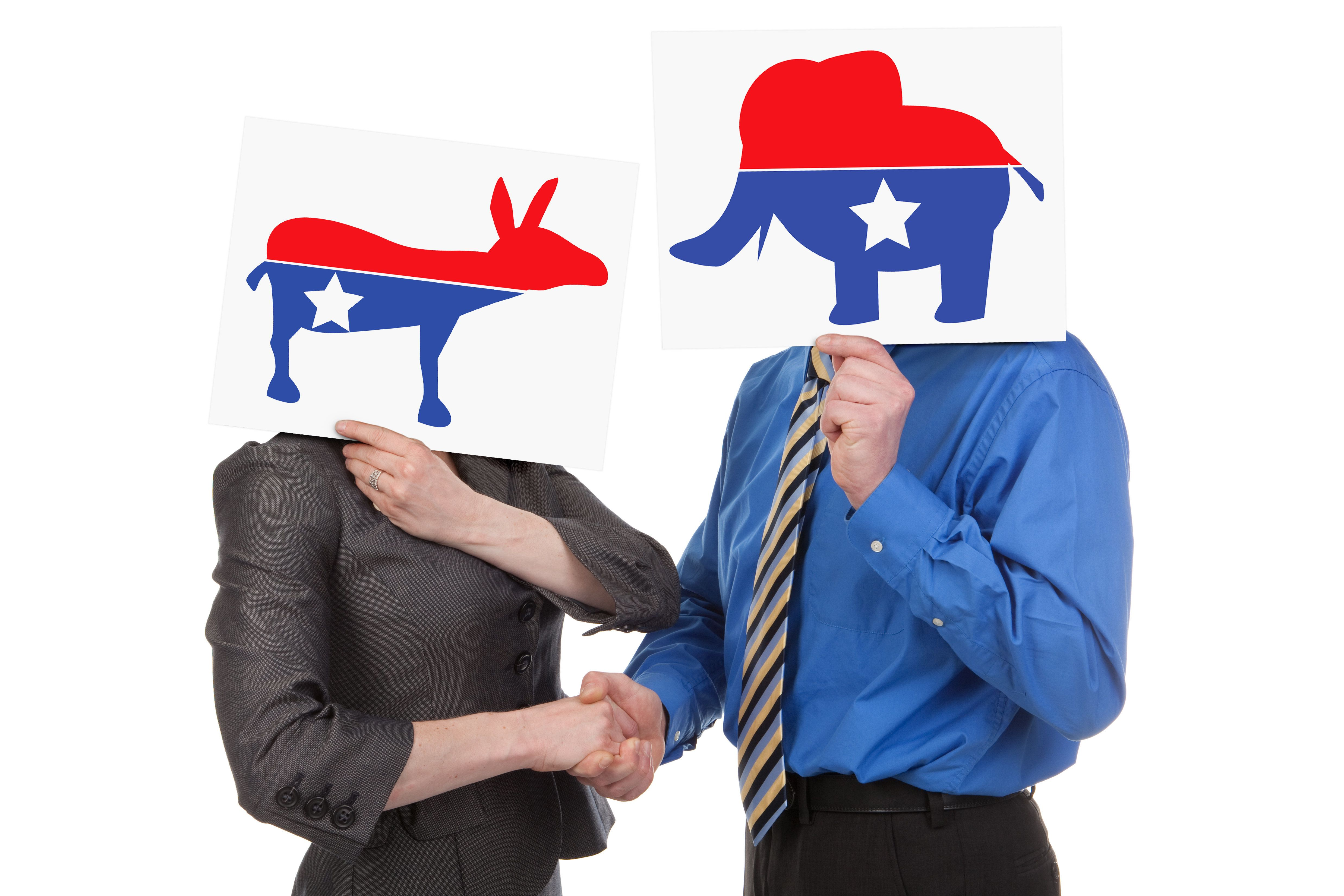 A democrat and republican shaking hands.  Graphics created by photographer.