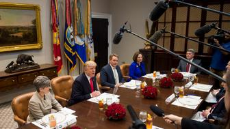 US President Donald Trump speaks during a lunch meeting with Republican members of the Senate, including US Senator Joni Ernst (L), Republican of Iowa, US Senator Jeff Flake (2nd R), Republican of Arizona and US Senator Deb Fischer (R), Republican of Nebraska, in the Roosevelt Room of the White House in Washington, DC, December 5, 2017. / AFP PHOTO / SAUL LOEB        (Photo credit should read SAUL LOEB/AFP/Getty Images)