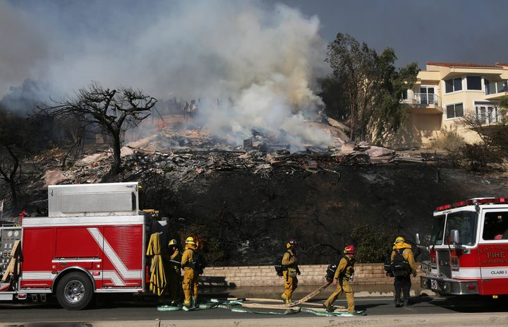 Firefighters were struggling to contain the blaze, which had burned more than 50,000 acres by Tuesday afternoon.