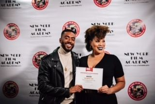 From left to right cast member Etienne Maurice  and Director Twinkie Bryd holding the award given by the African American Fil