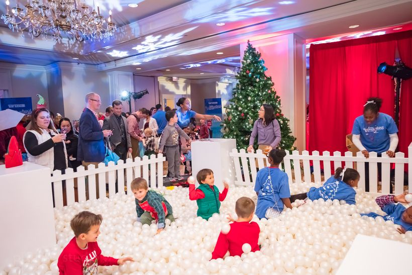Military kids enjoy some fun and games at Winter Wonderland Holiday Party.